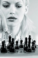 Woman playing chess game