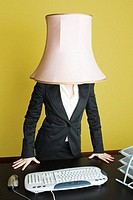 Businesswoman with lampshade on head.