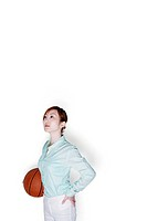 Businesswoman holding a basketball.