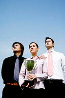 Corporate people with their trophy
