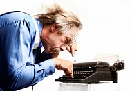 Businessman using a typewriter