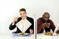 Businessmen enjoying their meal