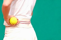 Close-Up of Female Tennis Player Holding Ball (thumbnail)