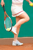 Close-Up of Female Tennis Player Picking Up Ball