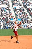 Male Tennis Player Hitting Ball