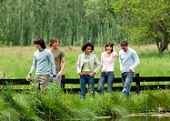 Group of young friends walking outdoors