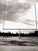A goalpost at a high school football in Upstate, New York is captured against a dramatic sky
