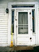 A weatherbeaten door on an old home in New England is captured during the winter