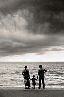 Family in front of the sea after the tsunami. Sri Lanka
