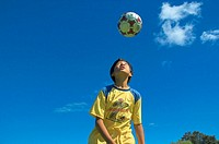 Western Australia, Perth, Chinese boy 'Erwin' heading football in park