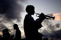 Trumpet player in El Malecón in the evening. Havana. Cuba