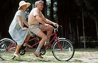 couple on a tandem bike