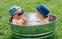 babies in a outdoor tub
