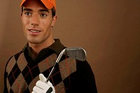 A golf player holding a golf club