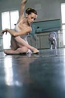 A female ballet dancer sitting in pose on the floor