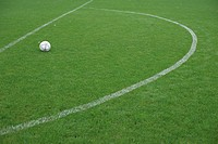 Football lying in a marked area, ready for direct free kick