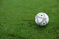 Football lying on grass