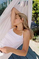 Close-up of a young woman lying in a hammock (thumbnail)