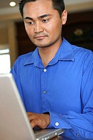 Close-up of a young man using a laptop