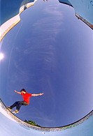 Skateboarding in empty swimming pool (fish-eye lens) (thumbnail)