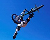 Low angle view of a person performing stunts on a bicycle