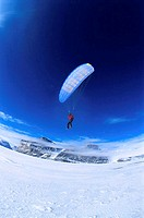 Low angle view of a person paragliding