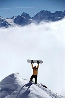 High angle view of a man holding up a snowboard