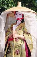 A costumed participant in the Jidai Matsuri representing Madame Fujiwara Tameie (Abutsuni), wearing the travelling dress mentioned in her diary.