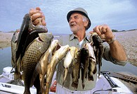 A day fishing in the Caspe lake on the Ebro river. Zaragoza province. Spain.