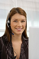 Woman wearing telephone headset