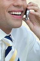 Smiling man talking on cell phone, close-up