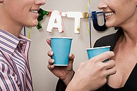 Two office workers toasting