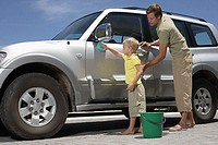 Father and son washing the car (thumbnail)
