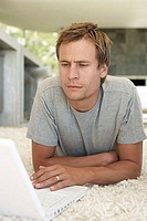 Portrait of man using a laptop computer