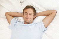 Mid adult man sleeping