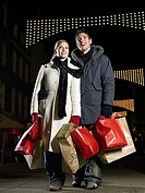 Mid adult couple christmas shopping (thumbnail)