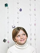 Portrait of a child with christmas decorations (thumbnail)