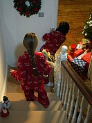 Children walking downstairs on christmas eve
