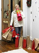 Woman returning home from christmas shopping