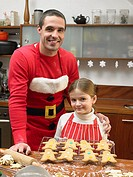 Father and daughter with gingerbread men