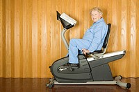 Senior woman on an exercise bike