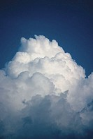 Low angle view of cumulonimbus clouds in the blue sky