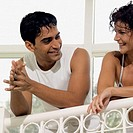 Smiling young couple standing on balcony