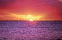 Majestic multi-colored sunset over purple sea