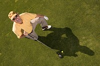 High angle view of a young man holding a golf club