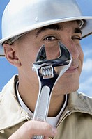 Portrait of a construction worker holding an adjustable wrench