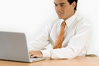 Close-up of a businessman working on a laptop