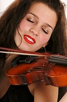 Woman playing violin, eyes closed, close-up