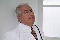Portrait of a male doctor looking up