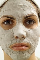 Close-up of a young woman with a face pack